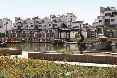 2015年,王厚勤在第一师十团翠湖雅居买了楼房。(资料图)谷水清 摄