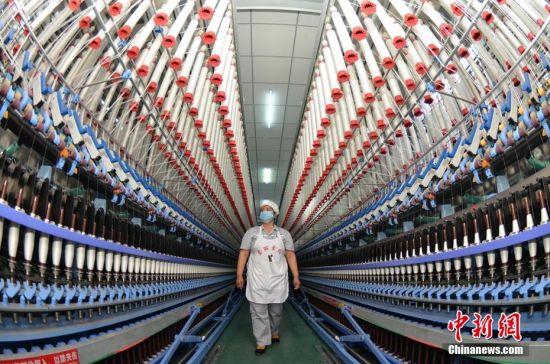 新疆南部纺织企业节后开足马力忙生产